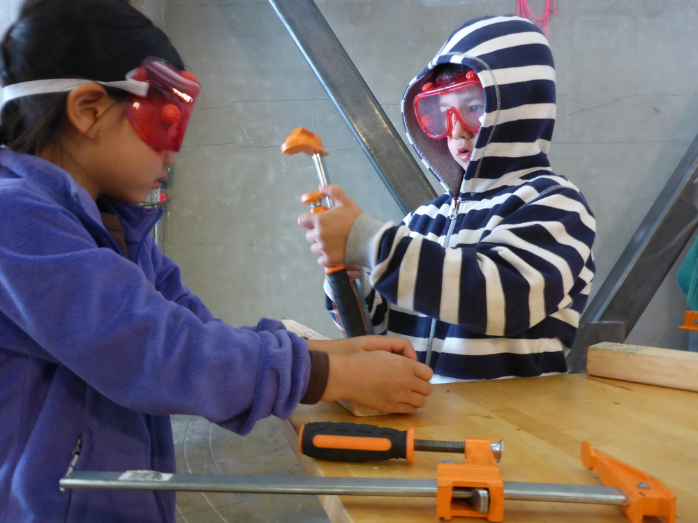 Nova and Jonas practice working as a team to clamp. Who knew that clamping sometimes requires four hands instead of two?