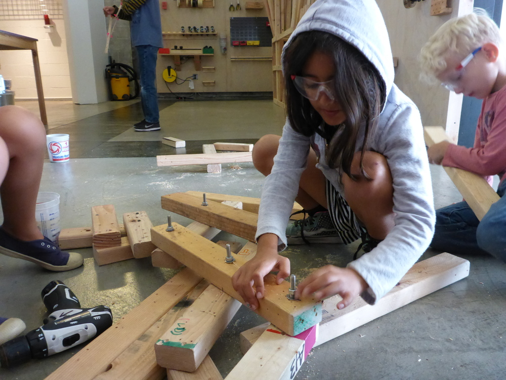 Vianna helps install bolts on the third iteration of the Space Probe robot arm. This is a pretty incredible creation!