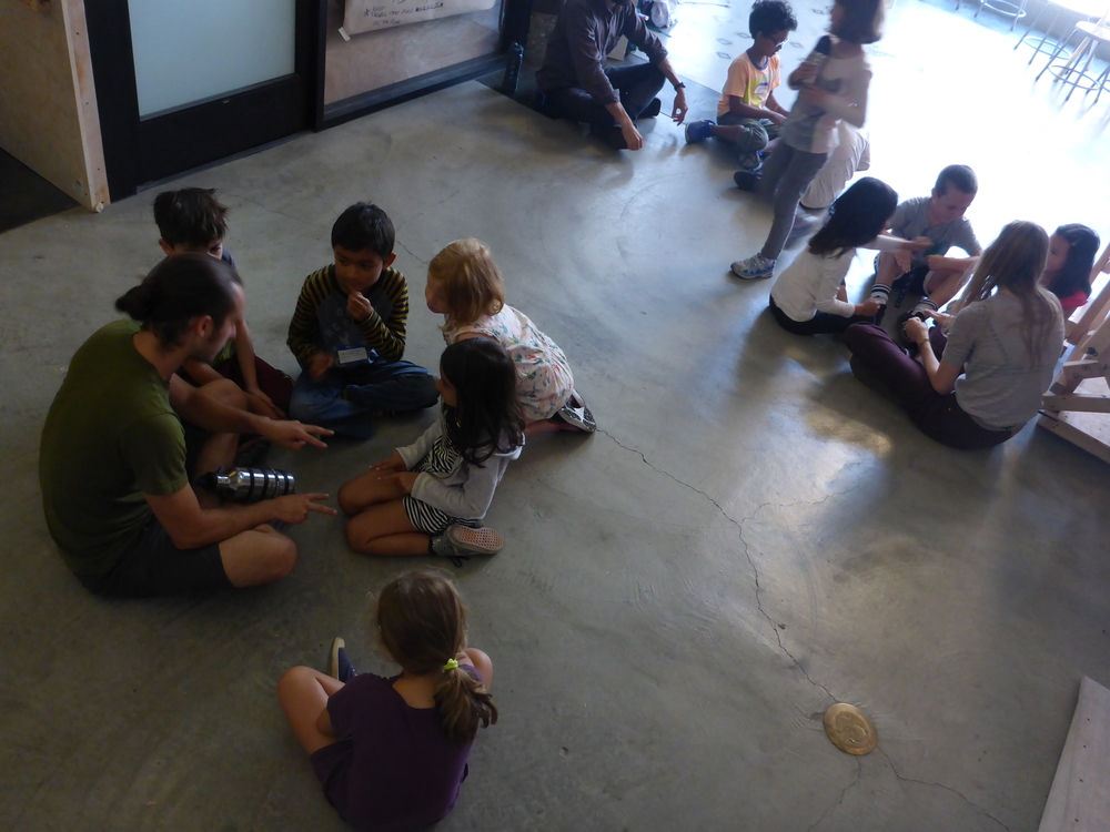 After eating lunch and playing outside, we came back and chilled out for a bit. The Tinkerers just naturally gravitated into small groups and started playing games with each other. It was pretty magical and almost painful to interrupt so that we could get back to building!