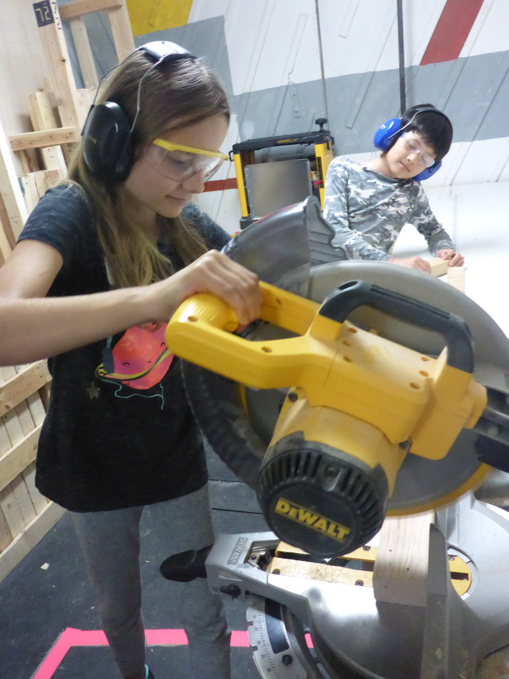 Sophie displays excellent form while using the chop saw.  everyone got a chance to try it out today after learning some finger-saving safety tips.