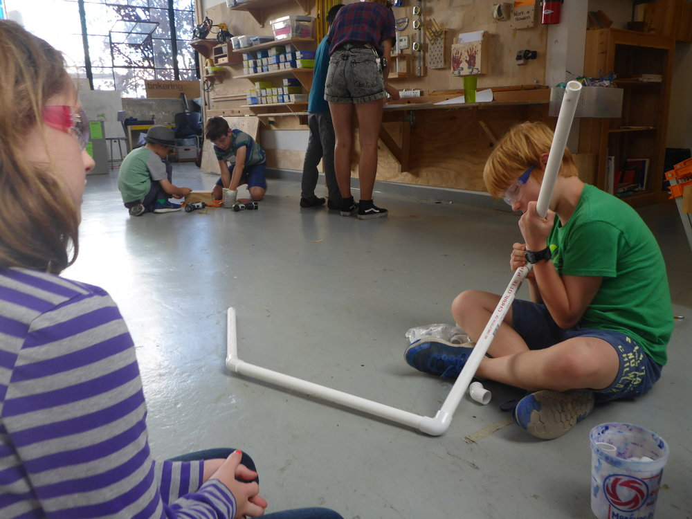 Festus (Jules) experiments with joining the PVC pipe together.