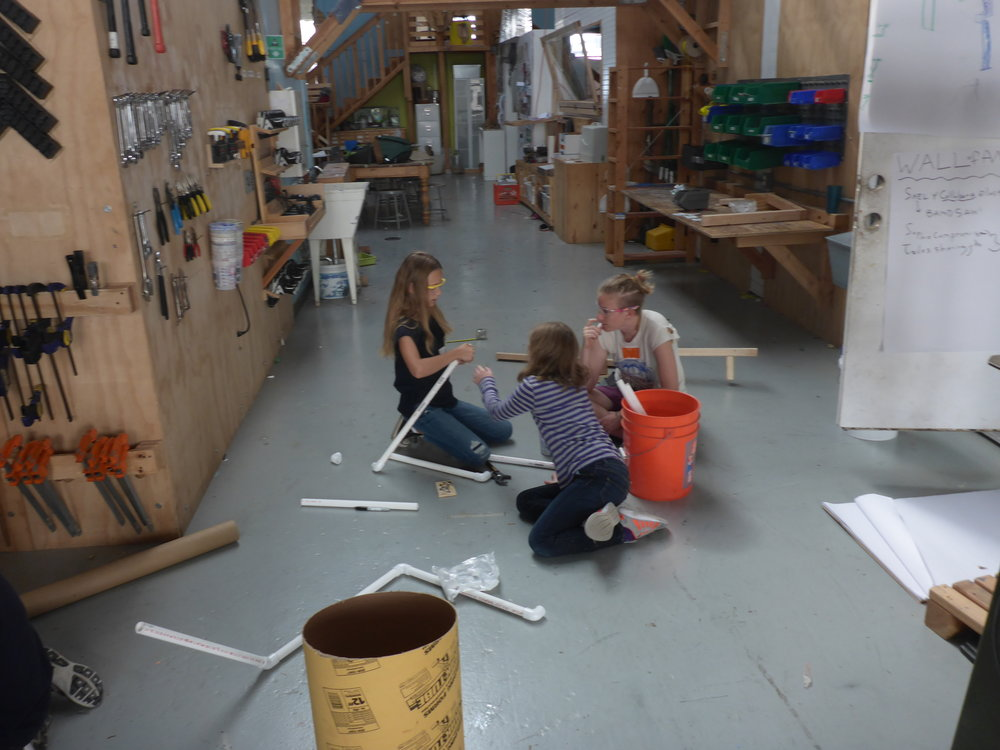 Sophie and Noe collaborate with Lindsay on pipe joinery as well.