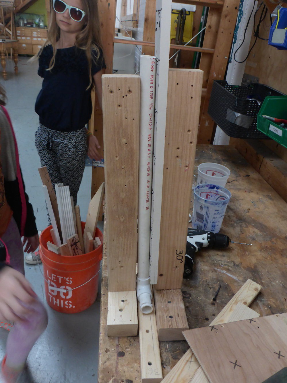 Final solution!  Sophie and Noe find the only piece of wood in the shop that could fill the gap!