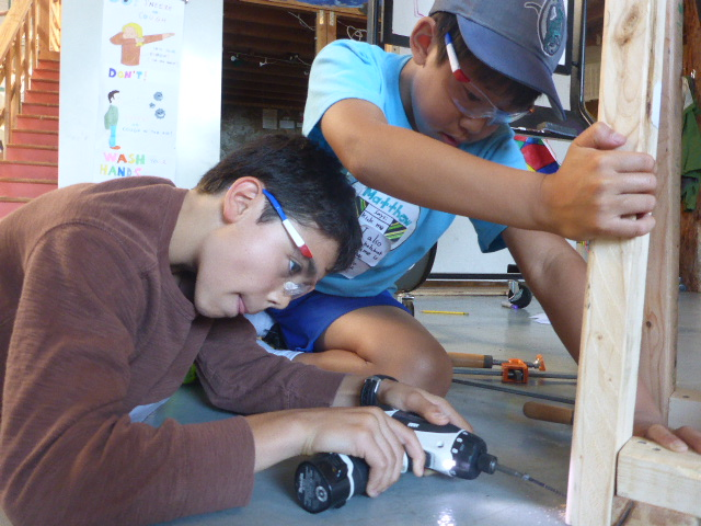 We had some amazing teamwork today! Matthew and Turin worked together to build the base of a ramp.