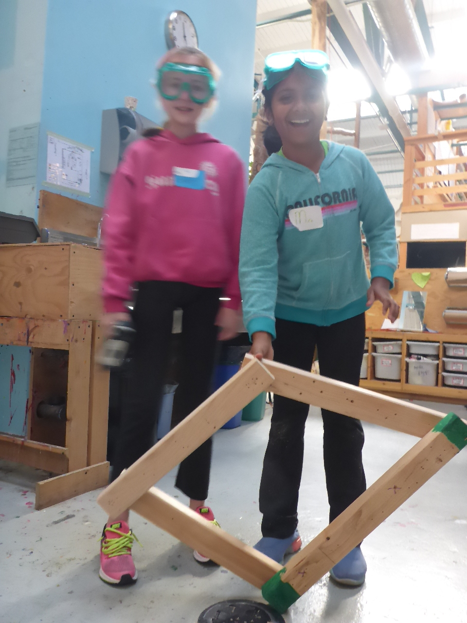 In order to make all these amazing things happen, first we had to learn to use the tools. Piper and Mira show off their shape-shifting parallelogram.