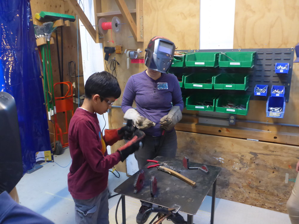 Rajan gets ready to weld on his house.