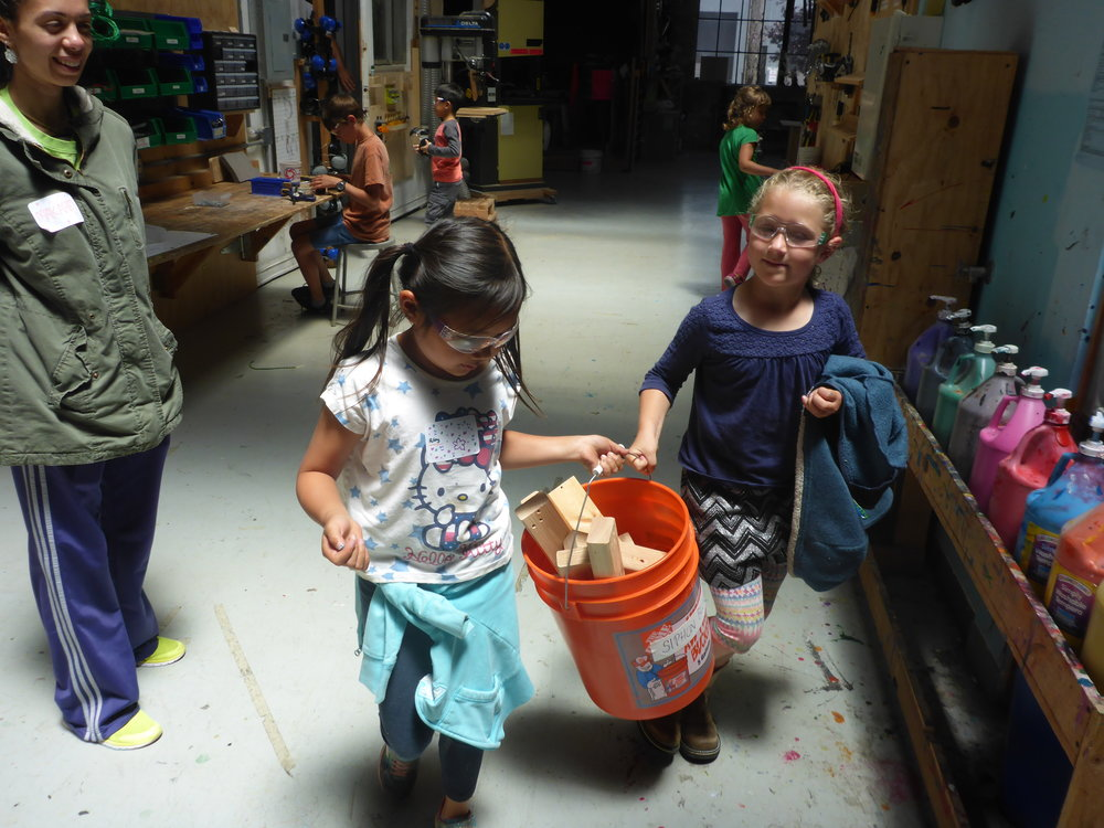 A little later, Riley helped Ella carry a bin of scrap pieces out to where Ella was working on her dragonfly wings. Keep it up Riley!