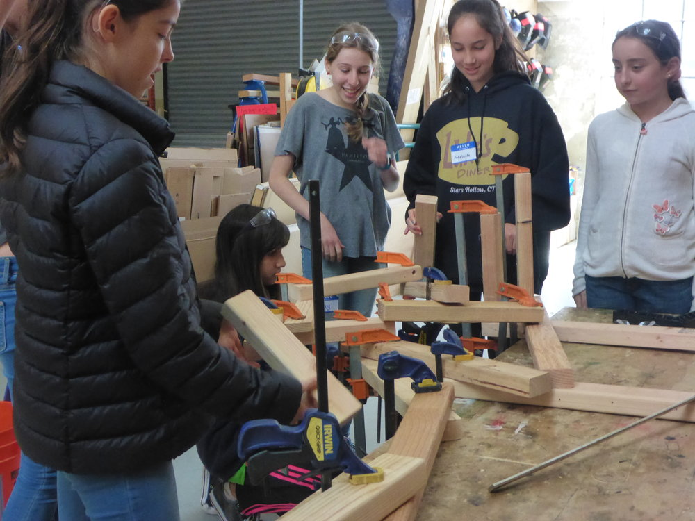 Leda, Audrey, Adelaide and Justine work on building a clamp-a-ma-jig in clamp training.