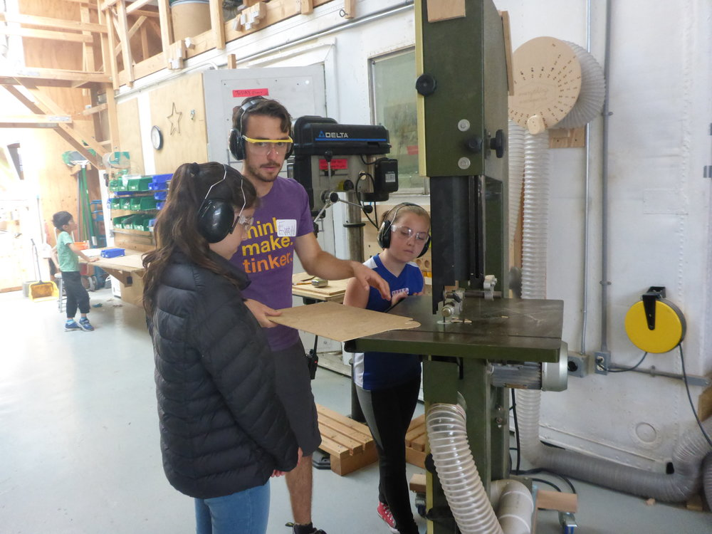 The turtle team started to add details, like giant teeth! Here, Daria and Leda learn some bandsaw basics in order to cut out a few turtle teeth.