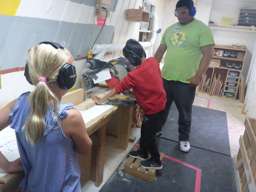 Lucille watches closely as Ved (aka Darth Vader) practices cutting on the chopsaw. Thank you for a great training Manny!