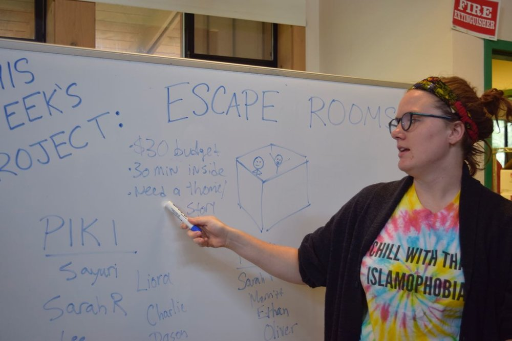 Kaitlyn introduces the project theme: ESCAPE ROOMS!