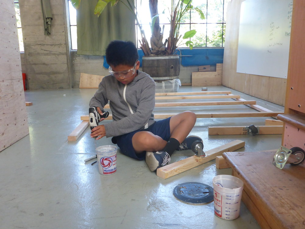 Matteo worked hard all day to prototype a way to install wheels onto the train cars. His plan is to construct a channel shaped track to keep the wheels in line.