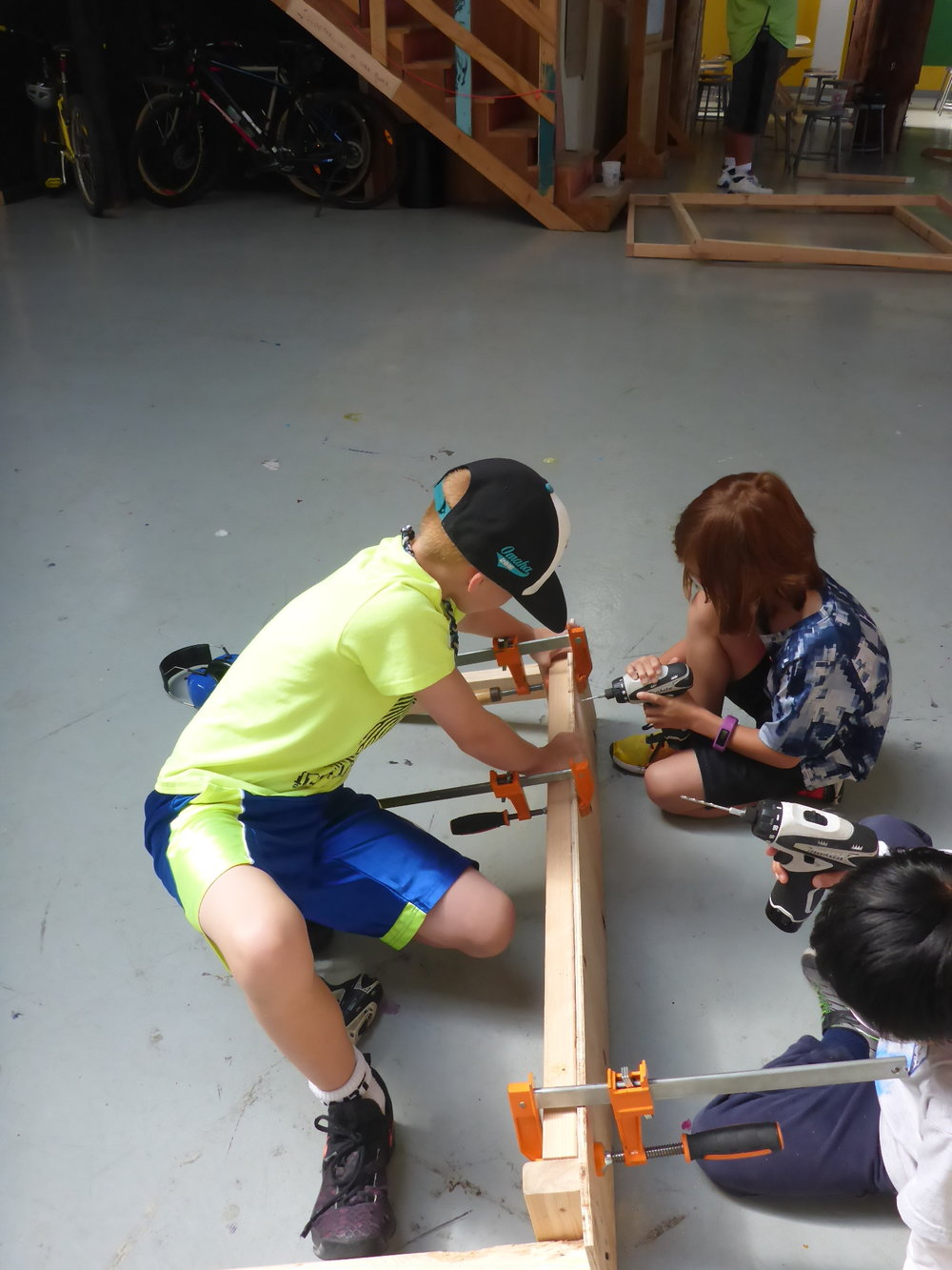"""Meanwhile, Carter, Graham and Preston added a 2x3 frame underneath the plywood seat of their bench to better support the sitter. """"We heard a creak when we tested it, so we added more supports."""" Good call!"""