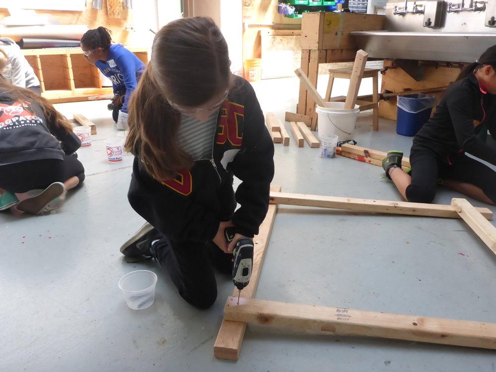 Emilia practices using the drill.