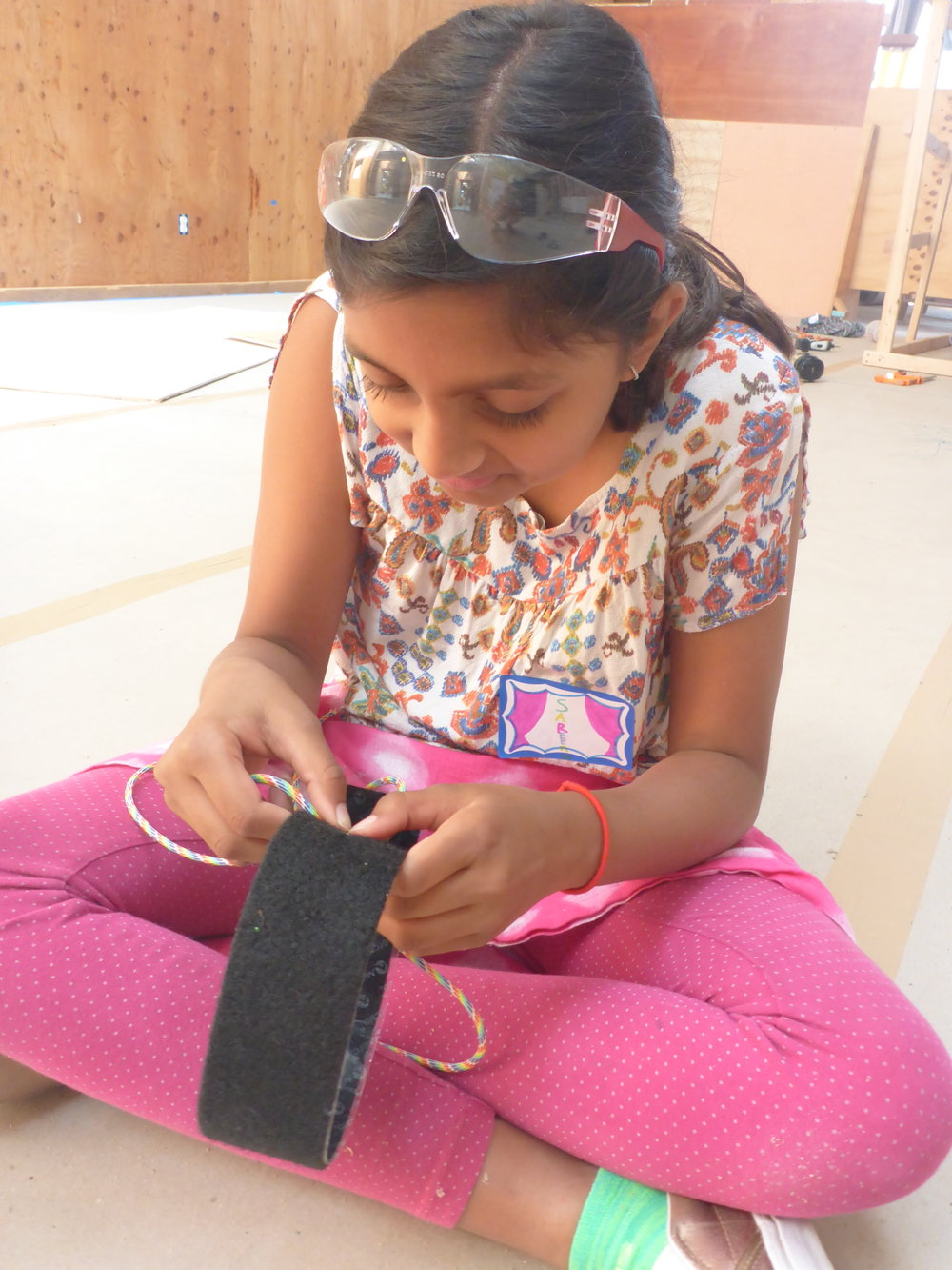 Meanwhile, tons of interesting stuff was happening over in the flywall group. Sareena got to work on designing and prototyping some wrist and ankle bands that can be used to climb the velcro on the flywall.