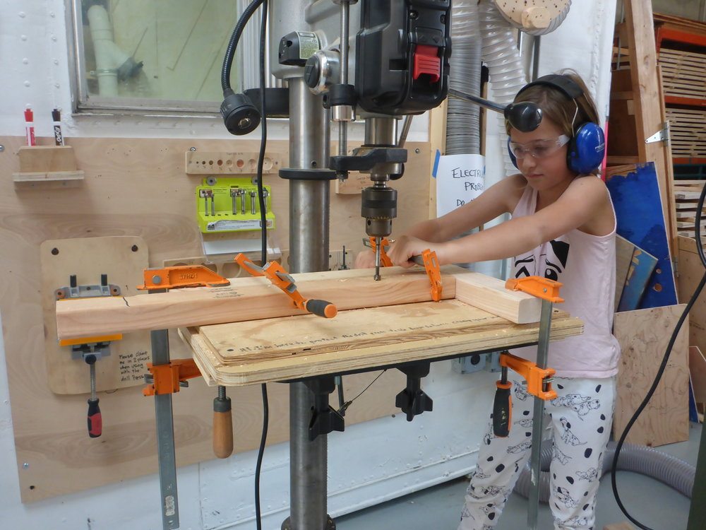 After a great demonstration and explanation from Sarai, Nina tried her hand at the drill press too--great jig setup Nina!