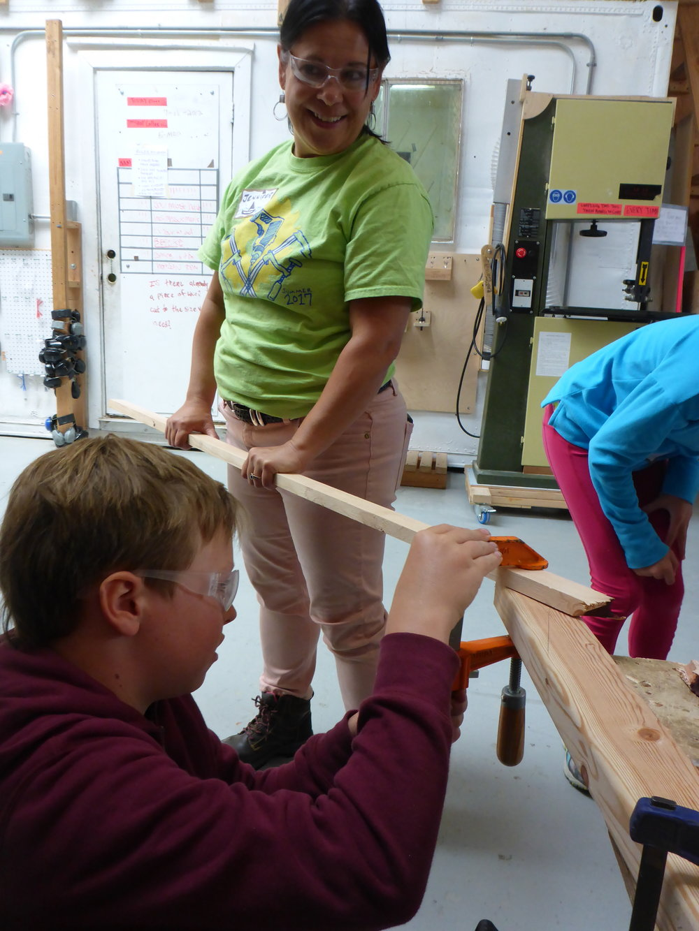 Jennifer helps hold a piece of wood in place while Wolf clamps it to the table. Thanks Jennifer!