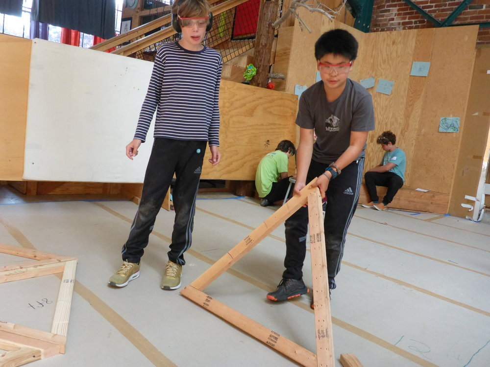 Isadore and Peter start to stage some of their equilateral triangles, while they figure out how they'll put them together to make the dome.