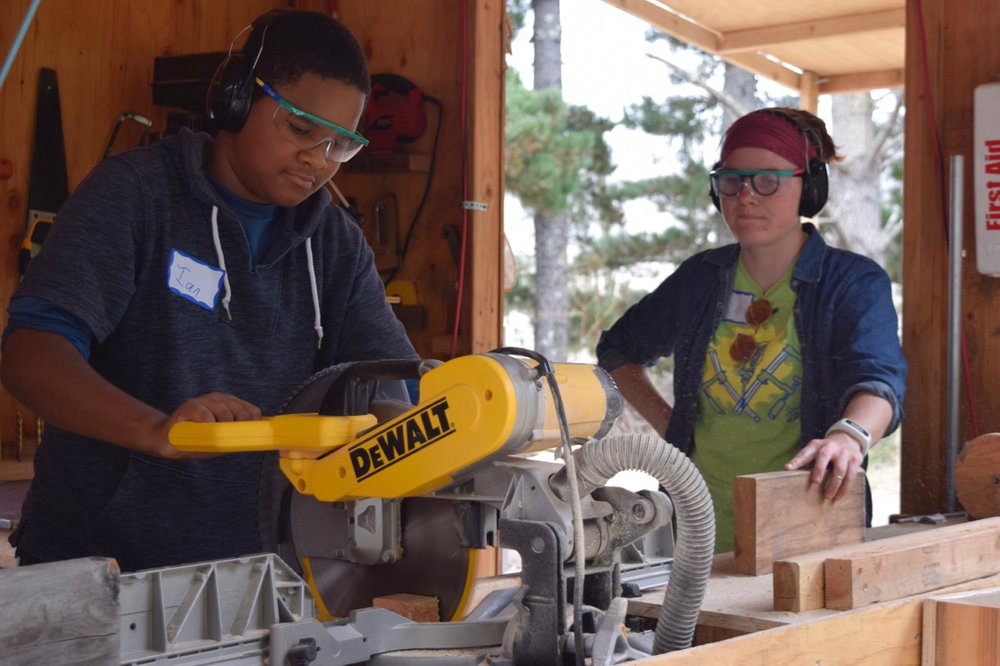Ian is the first to try the chop saw.