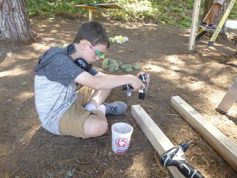 Cooper creates the legs for Team Panda's platform.