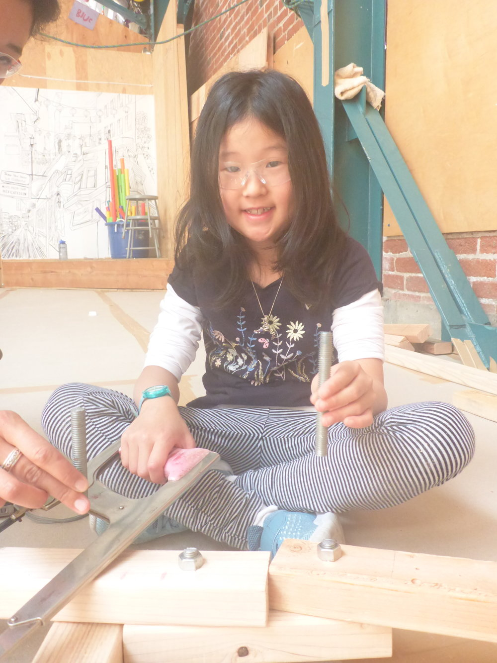 Sometimes hand tools do the trick! Ava shows off her work using a hacksaw :)