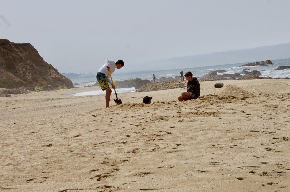 Kodi and Charlie bury Ben.