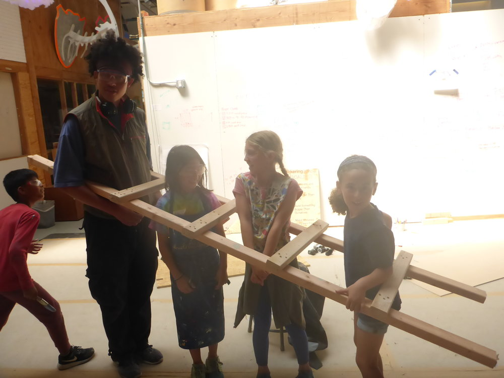 A ladder? A bridge? A collaborator catcher? When tinkering, a few sticks of wood can become anything!