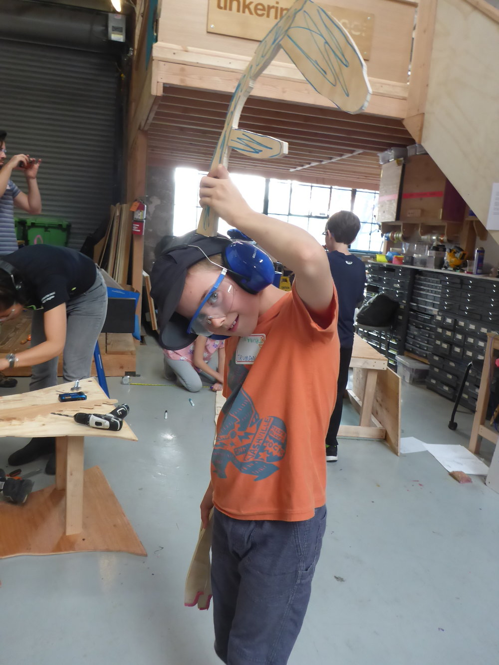 Truman proudly demonstrating how the dragon horns he cut out will attach to the dragon's head. They will also function as handles for the rider.