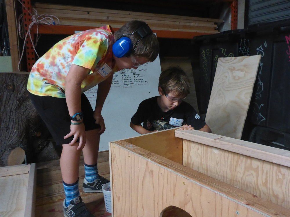 Jackson showed August the rider cubicle that will be attached under the dragon's belly.