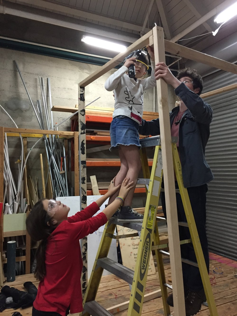 "Esme, Nola, and Jack get out the ladder for first part of ""Blobby dog's"" house :)"