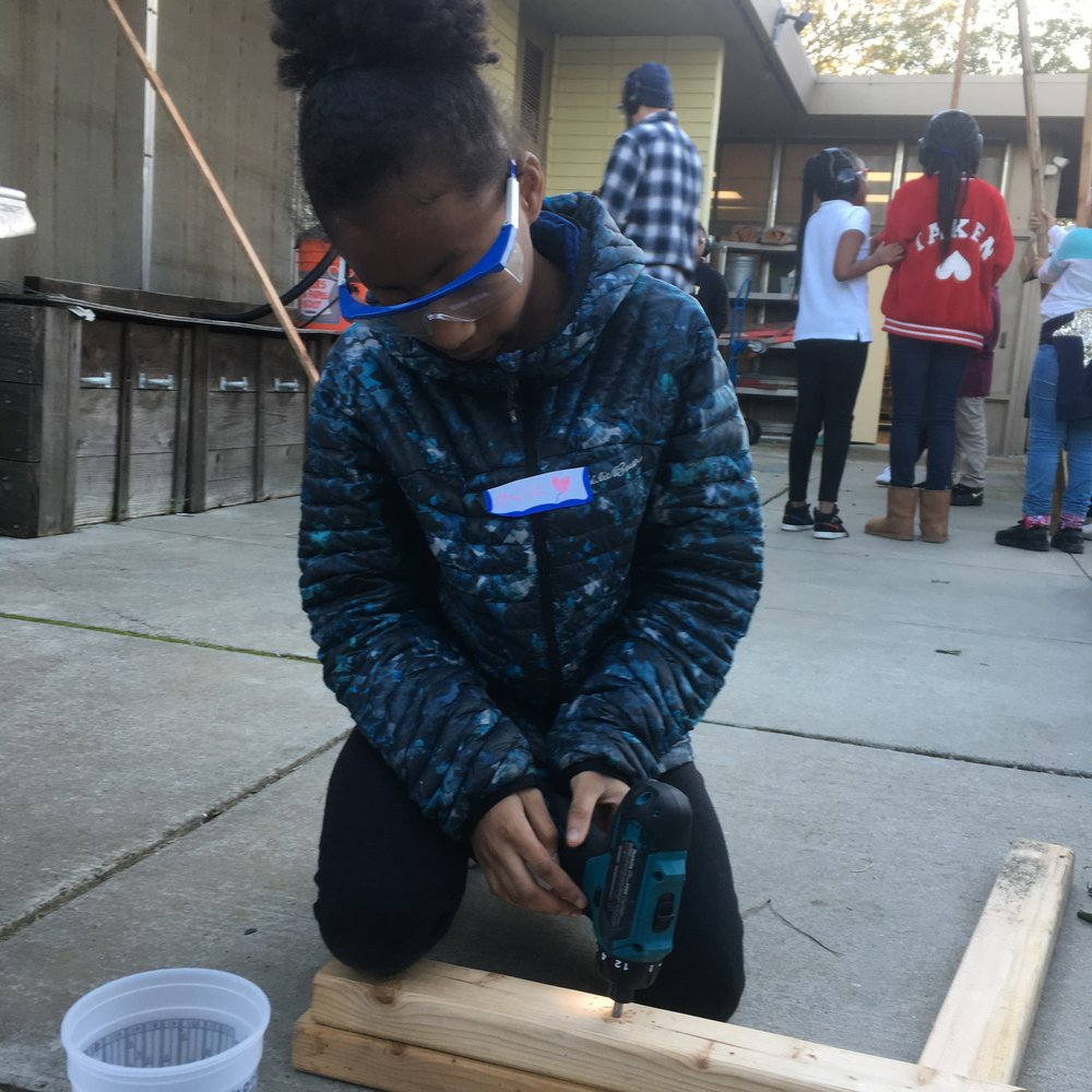 Malia is one of our returning tinkerers! Here she helps build the 8 foot long frames for our train tracks.