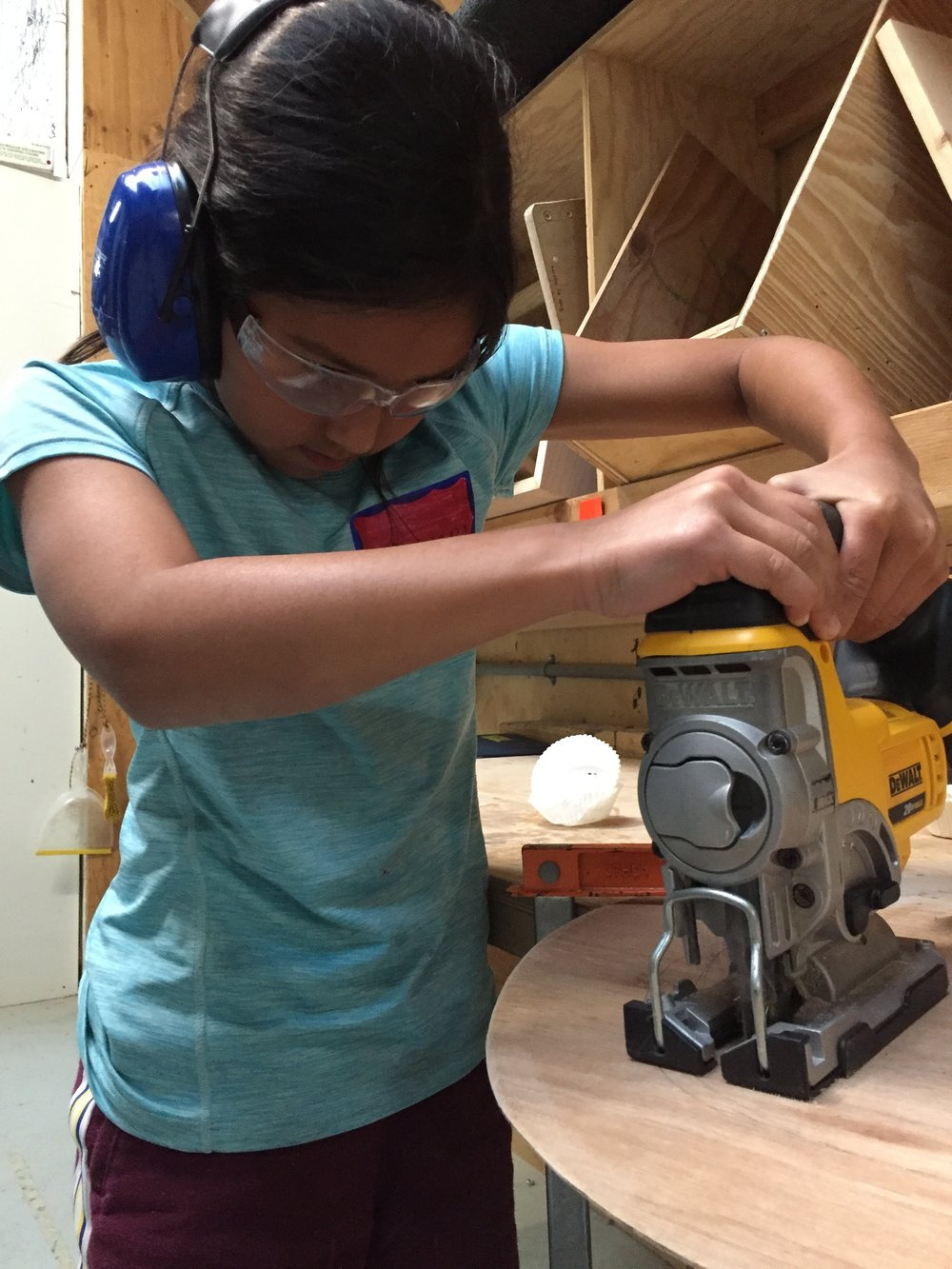 Ayana practices with the jig saw. Great two handed form!