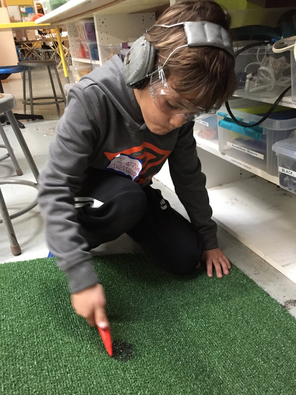 Zane gets the putting green ready for testing!