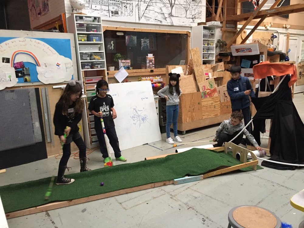 Testing time! Esme, Ayana, Nola, Moss, and Matthew test out the Volcano putting green.Success!!