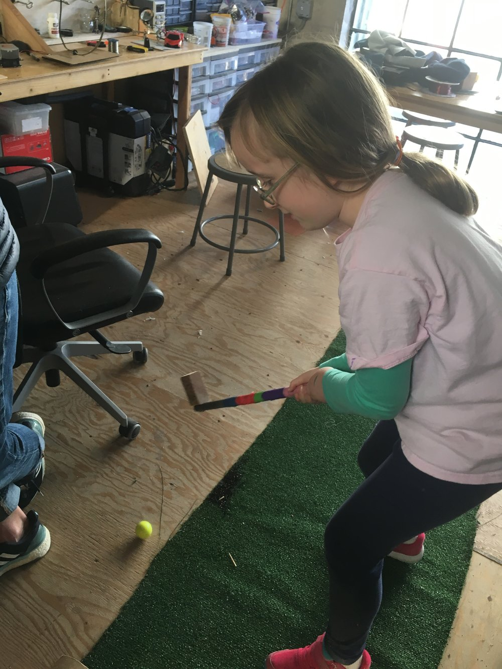 Ava is the first to putt for the Bob the Dragon, Dragon-Golf course.