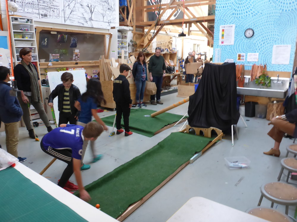The Volcano course in action. You have to hit your gall ball into the center tunnel in order for it to be transported up the pulley powered elevator. At the top of the elevator, the golf ball is dumped into the cardboard tube for a hole in one if your lucky!