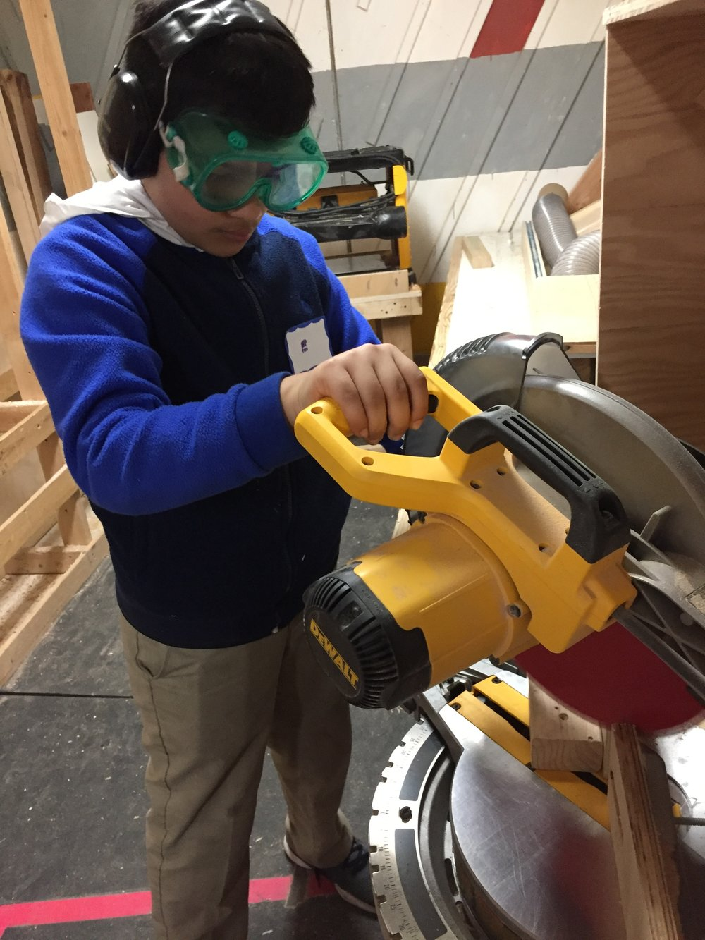 Edwin makes a mitered cut for the supports of the walls of the maze.