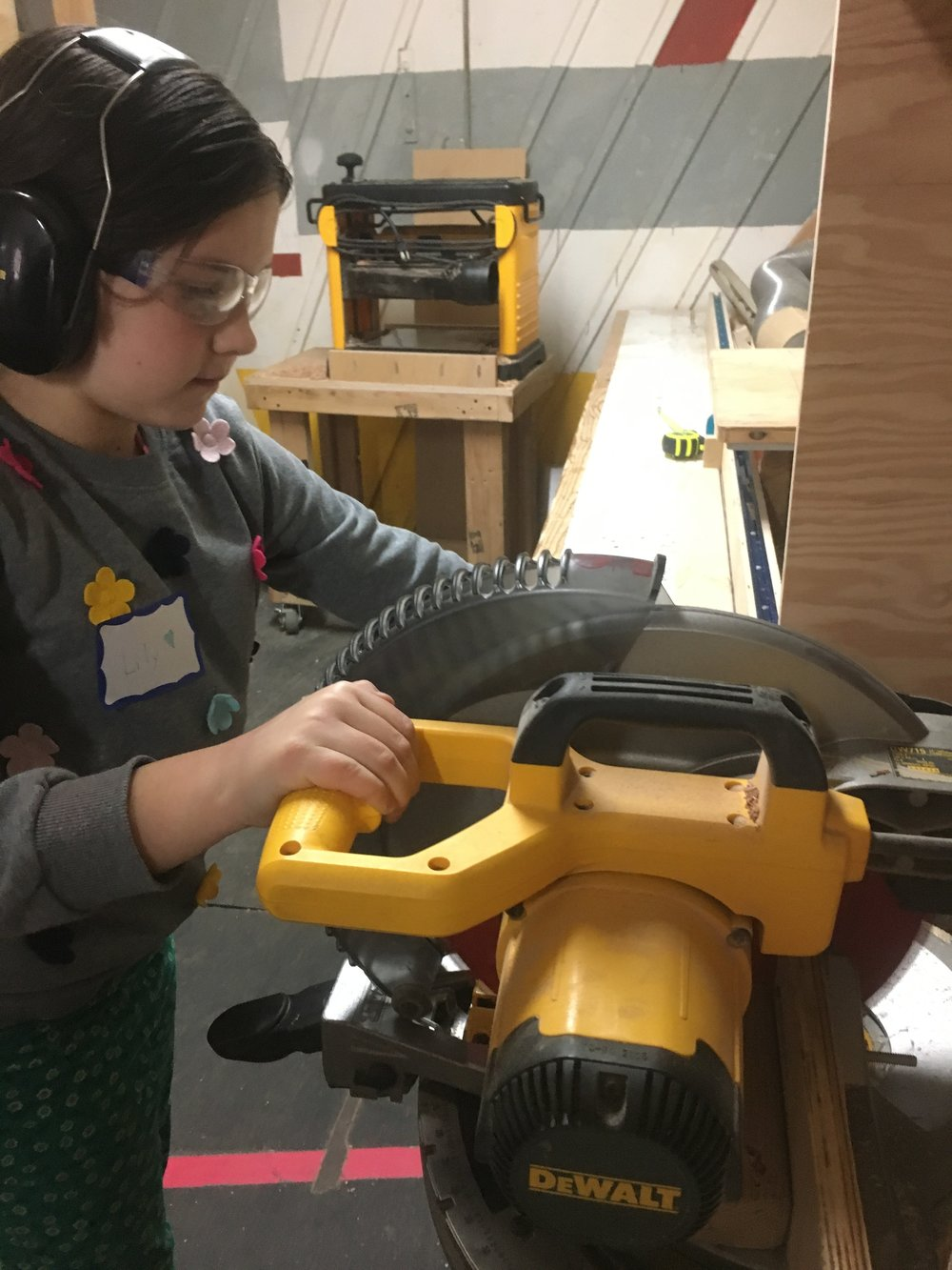 """Lily cuts 2x3"""" for the frame of her group's first train car."""