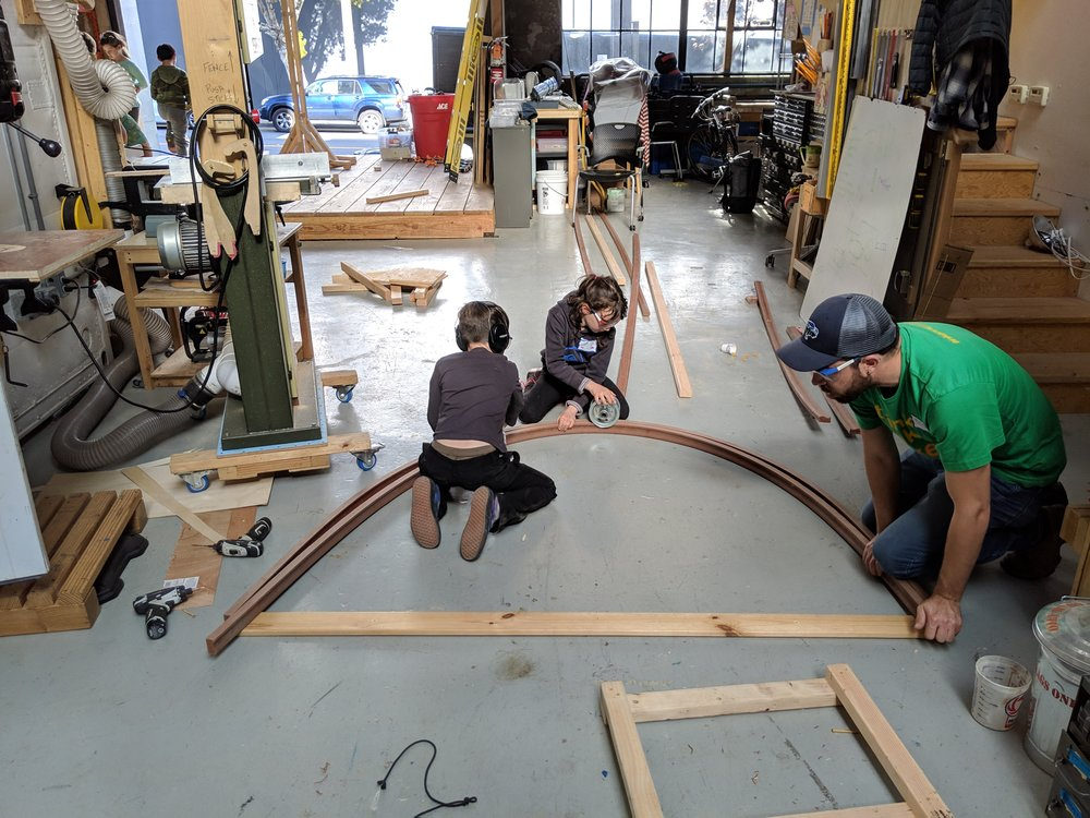 The train track group had some engine-eous ideas for making the tracks curve by using a decking material called TREX.