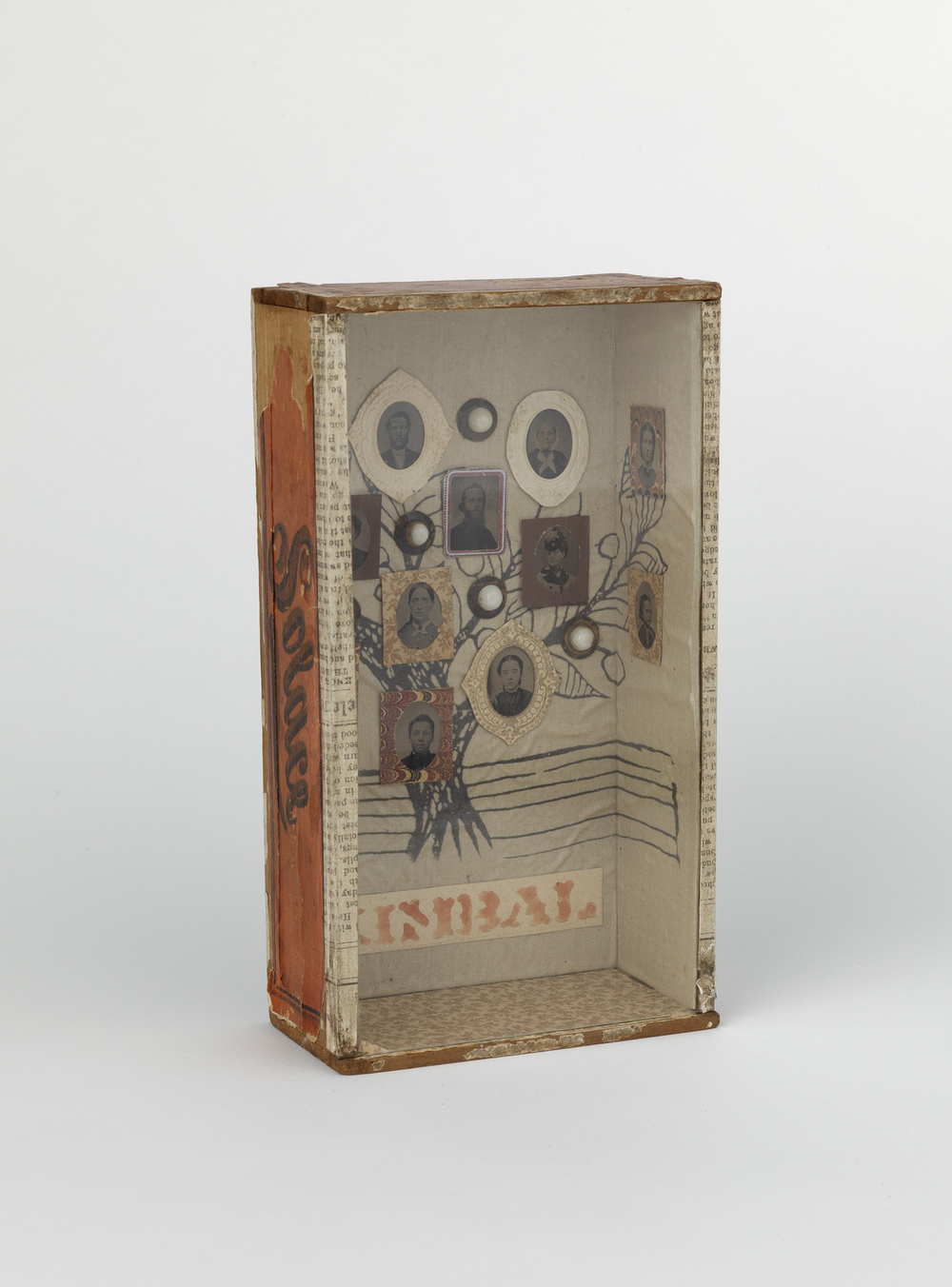 Shadow box with tintypes of the Kimball Family set against contemporary batik fabric.  1880s-1990s