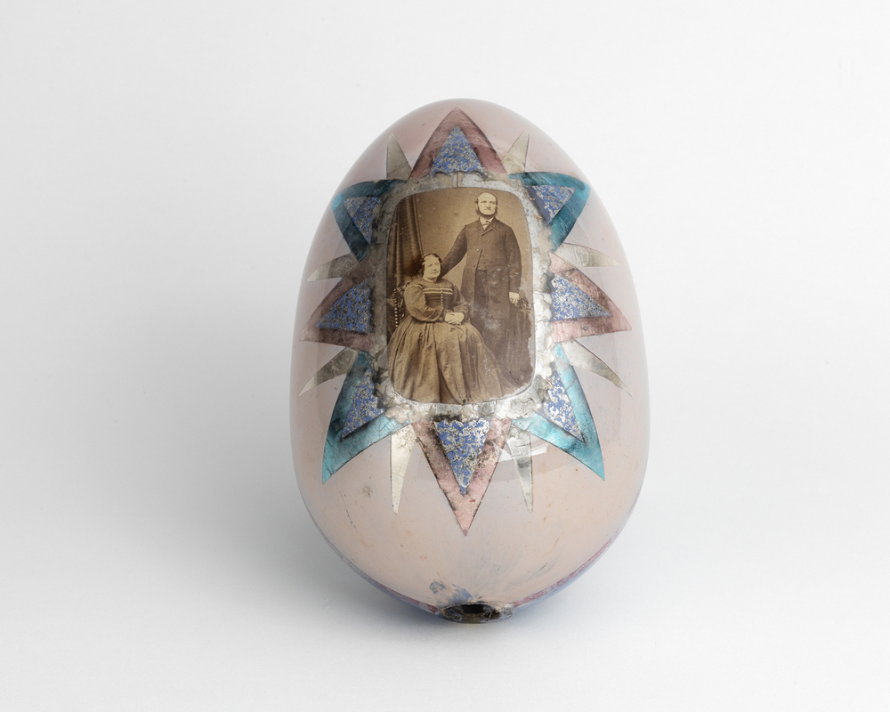 Hand painted glass egg with original photograph of a couple. 1880s
