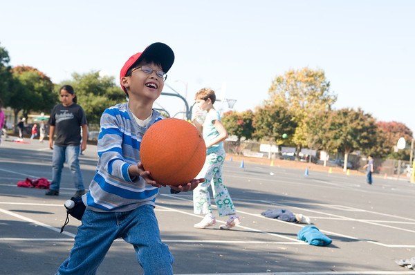 Boy plays Four square at a playworks recess.