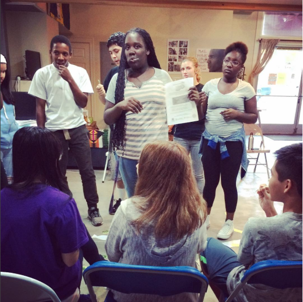 Youth participating in a role playing activity on organizing.