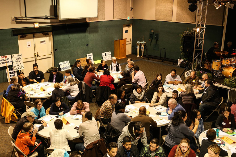 Oregon tenants and legislators fill several round tables at a listening session for Stable Homes for Oregon Families.