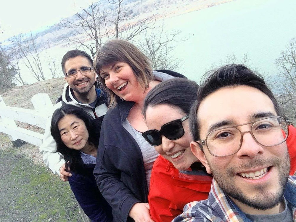 Suk and the rest of NWHF's Program Team take a selfie next to a river.