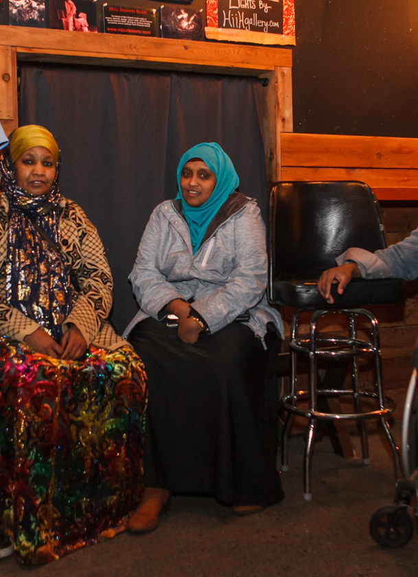 Saara sits with other members of her African immigrant/refugee community.