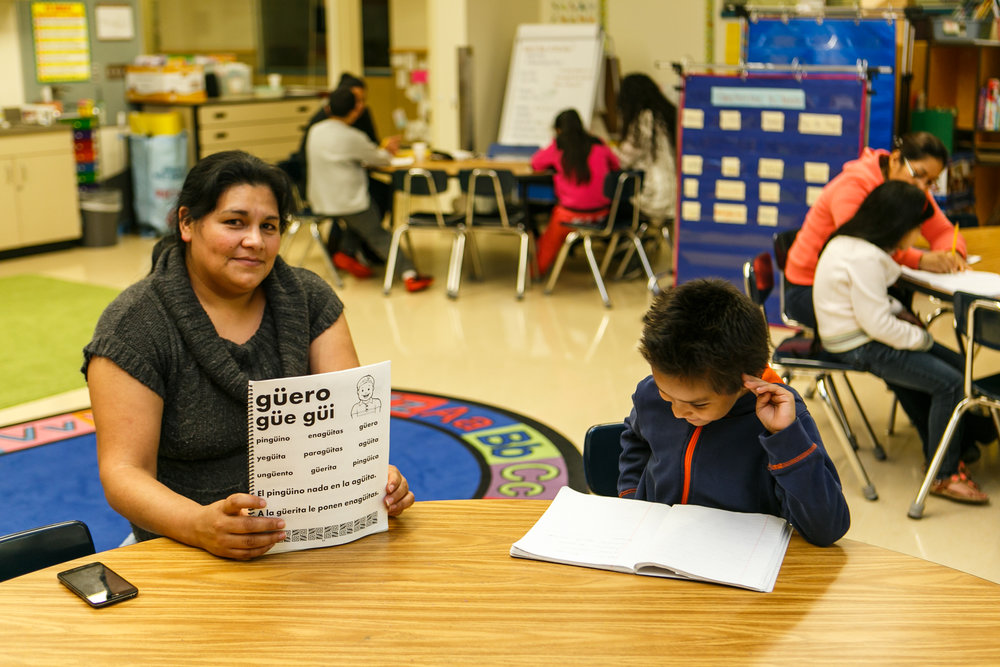 A mother and son practice reading together at SKCE's Leyendo Avanzamos program.