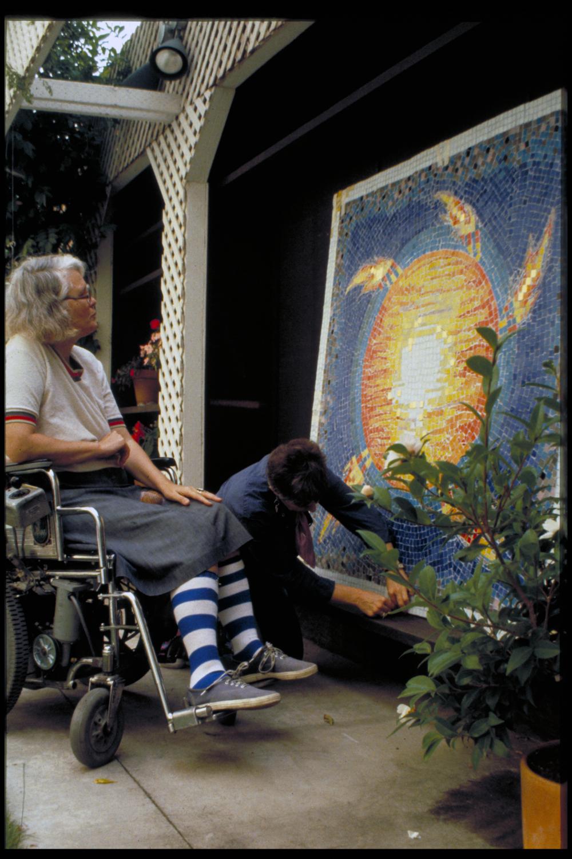 mosaic artist in garden.png