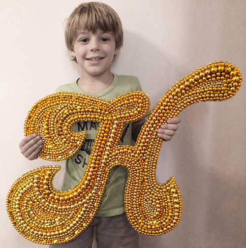 Hen loved Marie's M so much that he requested an H for his room...in his favorite color gold...