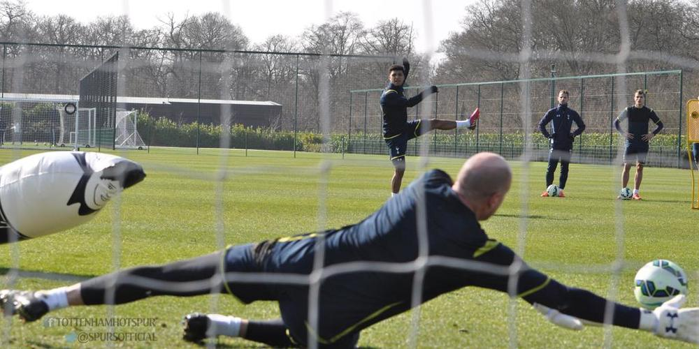 DeAndre Yedlin takes a shot on Friedel as an inflatable dummy bows at Friedel's greatness. Fun fact: Friedel had already had played for the United States before Yedlin was born.